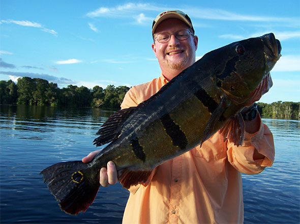 Dan Kimmel with a 16 1/2 pound Speckled Peacock Bass caught from the Rio Negro on a woodchopper topwater while being guided by Aligator in February 2012